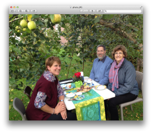 Pastorin Ursula Sieg in the Sukkah with her husband, Pastor Martin Pommerening and Vickie .  Martin and Ursula built the Sukkah of us in their backyard in Bad Segeberg
