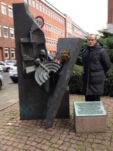Standing next to the monument on the site where the Great Synagogue in Kiel once stood