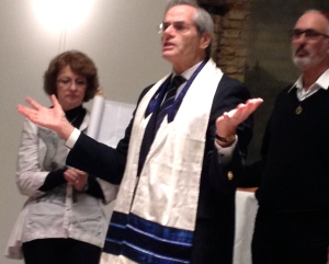 Explaining the Torah portion. We read from a replica Torah scroll held up for the reading by Rita and Horst Blunk.