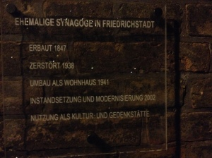 Sign outside the Synagogue: It says: Former Synagogue of Friedrichsstadt Built in 1847 Destroyed by the Nazis in 1938 Used as a Private Home in 1941 Rettsored to the Jewish Community in 2002 Now used as a Cultural Center